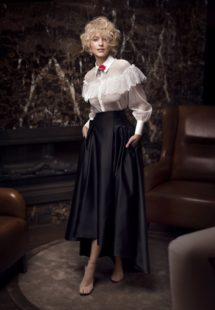 Style #330, black & white skirt combo features lace blouse with ruffles and top underneath, high-low skirt wih pockets, top available in nude, pink, ivory; skirt available in black; blouse available in ivory