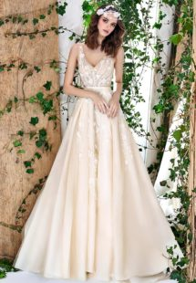 Style #1802L, sleeveless a-line wedding dress features v-neckline, open back, 3-D floral embroidery down the skirt with side pockets, available in ivory and caramel