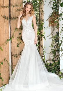 Style #1810L, fit and flare silhouette wedding gown with lace embroidery, illusion plunging neckline, and keyhole back, available in ivory and light pink