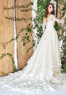 Style #1812Pr, fit and flare silhouette with natural waistline, corset style top, handmade floral décor on bottom, corset on back with tie up string, available in ivory