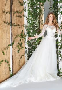 Style #1812LS, three-quartered sleeve ball gown wedding dress, designed with the illusion neckline and lace scalloped hem, available in ivory