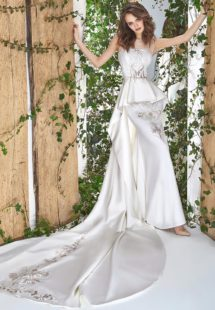 Style #1813L, illusion neckline sheath wedding gown with peplum skirt and lace embroidery, available in ivory