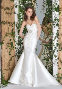 Style #1814L, satin trumpet wedding dress features a sweetheart neckline, lace embroidery down the skirt, crisscross spaghetti straps over the low back, available in ivory