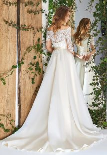Style #1824L,off the shoulder a-line wedding dress with three-quarter length sleeves, lace over the bodice, and organza skirt, available in ivory and cream
