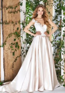 Style #1825L, cap sleeve a-line wedding gown, designed with illusion sweetheart neckline, low back, pockets, and lace embroidery on top, available in cream and ivory