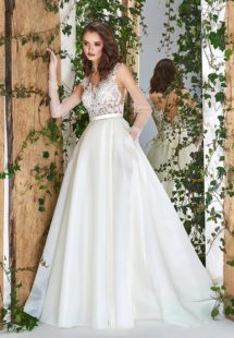 Style #1833L, illusion neckline ball gown wedding dress with organza skirt, and open v-back, available in ivory