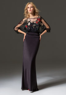 Style #334, fit-and-flare evening gown features flower embroidered illusion top with dolman three-quarter length sleeves, available in black
