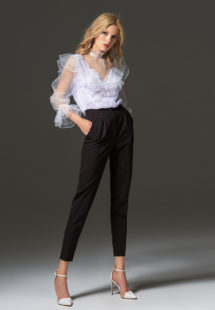 Style #338-3, high collared lace blouse with sheer bishop sleeves and ruffled details, available in white. Style #338-4, mid-rise skinny trousers, available in black, ivory, scarlet, dark blue, blue, pink-ivory, green, grey