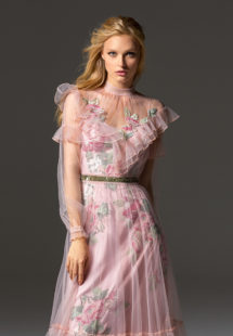 Style #341, long sleeve evening dress features an illusion high neck with ruffled details, and flower embroidered lining dress with the sheer overlay skirt, available in pink-ivory