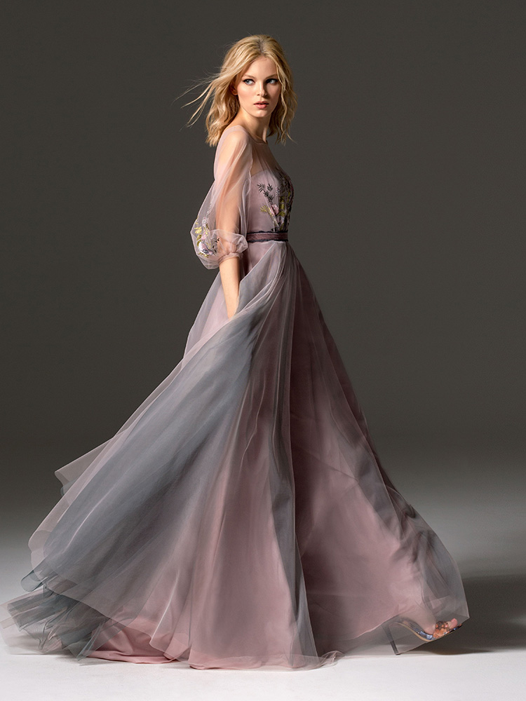 Style #343, long evening gown with an illusion neckline, three-quarter length bishop sleeves, floral embroidery, and velvet belt, available in grey, pink-ivory, ivory