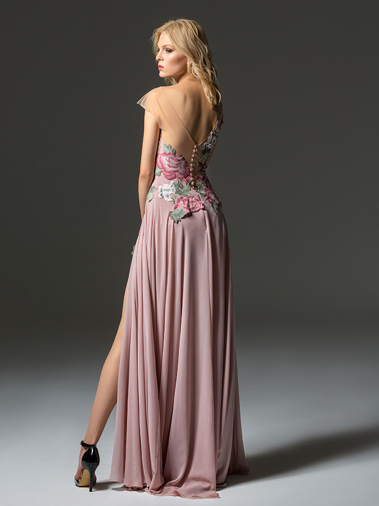 Style #360, cap sleeve maxi dress with an illusion neckline, embroidered top, and front slit on the skirt, available in pink-ivory