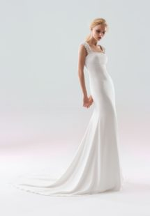 Style #1901L, fit-and-flare wedding gown with embellished straps and low illusion back, available in ivory