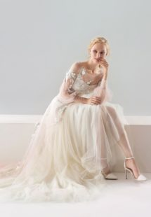 Style #1907L, bishop sleeve A-line wedding dress with floral lace embroidery and illusion back, available in ivory-pink