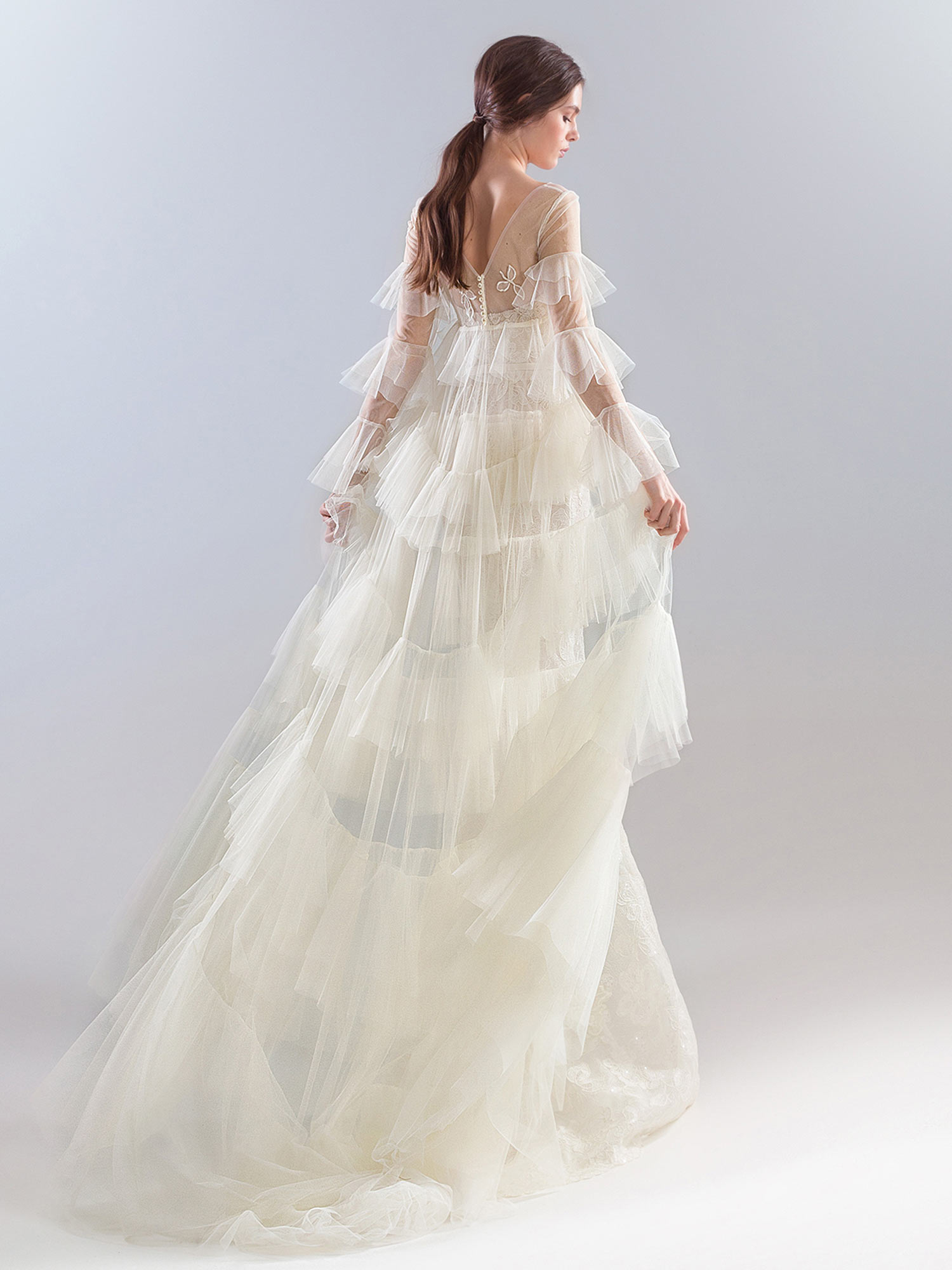 Style #1927L, available in dark ivory (photo), ivory; Style #1927-7 (cape), available in ivory