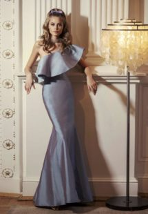 Style #524, mermaid maxi dress with one shoulder neckline, and large ruffle, available in black, turquoise