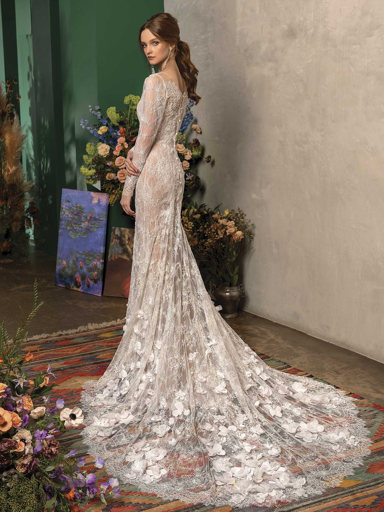Style #2027L, Mermaid wedding dress with long sleeves, and floral train, available in ivory; 2027-1, available in nude and ivory