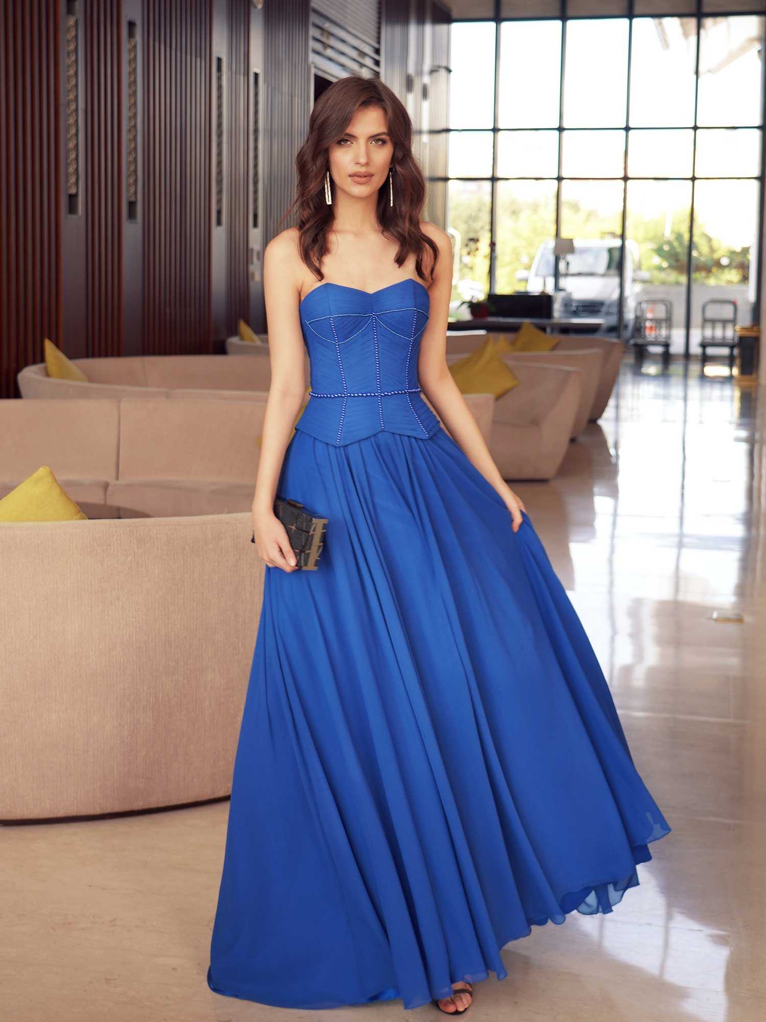 Style #551, formal dress with a flowy skirt and structured bodice, available in cornflower, cherry, black, powder, azure, ivory