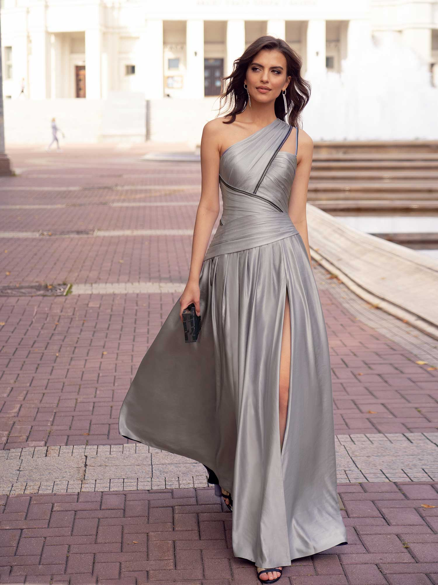 Style #572, luxury formal dress with asymmetrical designs and slit on the leg, available in grey, terracotta