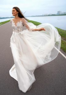 Style #12058, bridal gown with bishop sleeves and embellished bodice, available in ivory