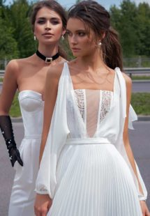 Style #12062a, modern wedding dress with pleated skirt and long cutout sleeves, available in ivory-nude