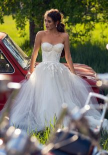 Style #12063, wedding dress with bustier bodice and floral embroidery, available in ivory