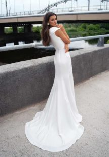 Style #12066, modern bridal gown with wide V neckline and belt, available in ivory