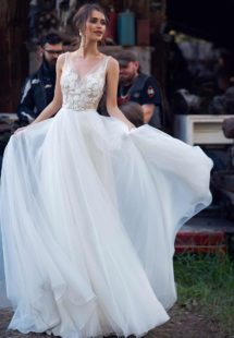 Style #12071 ,modern wedding dress with floral applique and low back, available in ivory, ivory-nude
