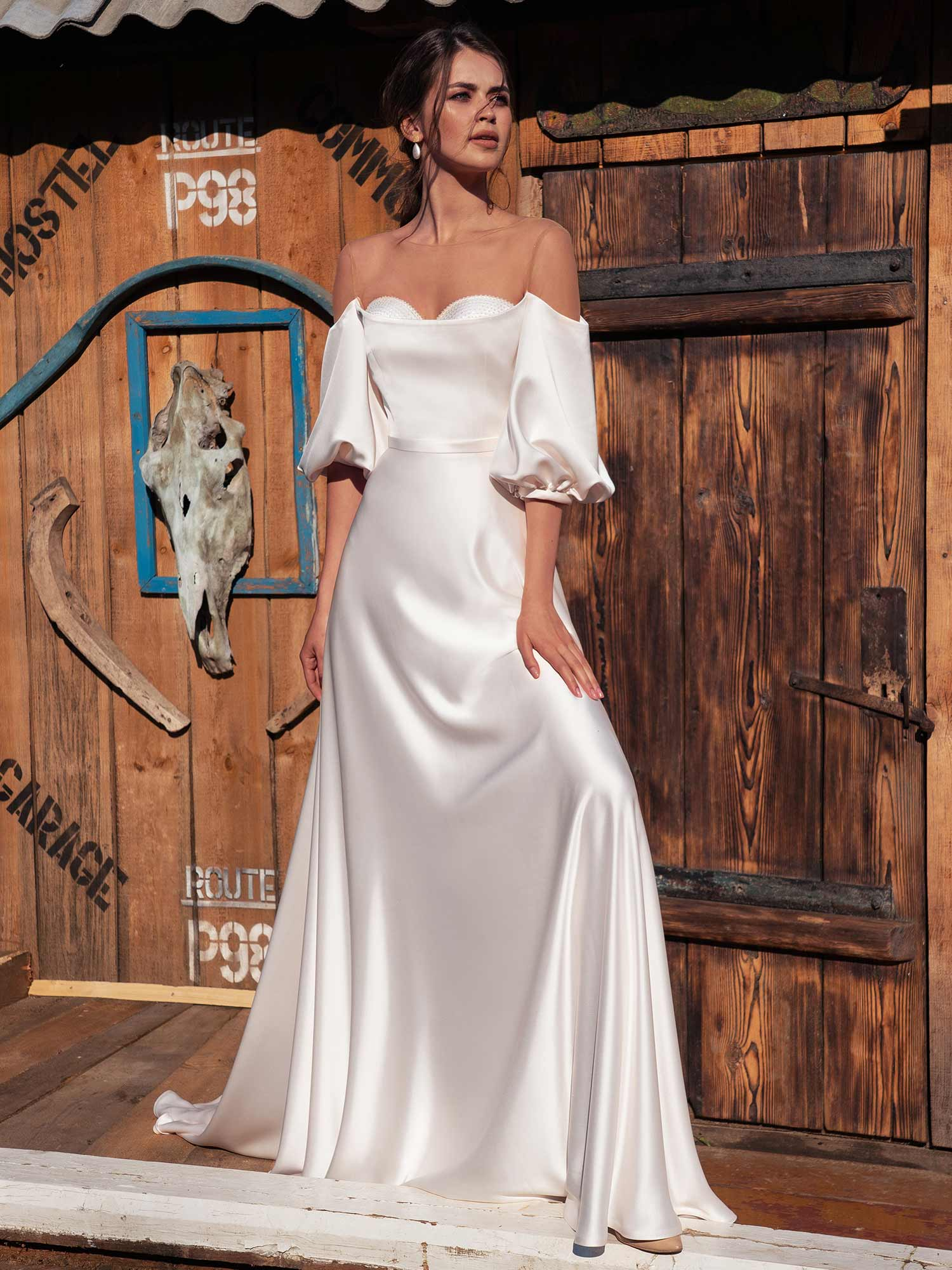 Style #12072, off-the-shoulder wedding dress with bishop sleeves, available in ivory