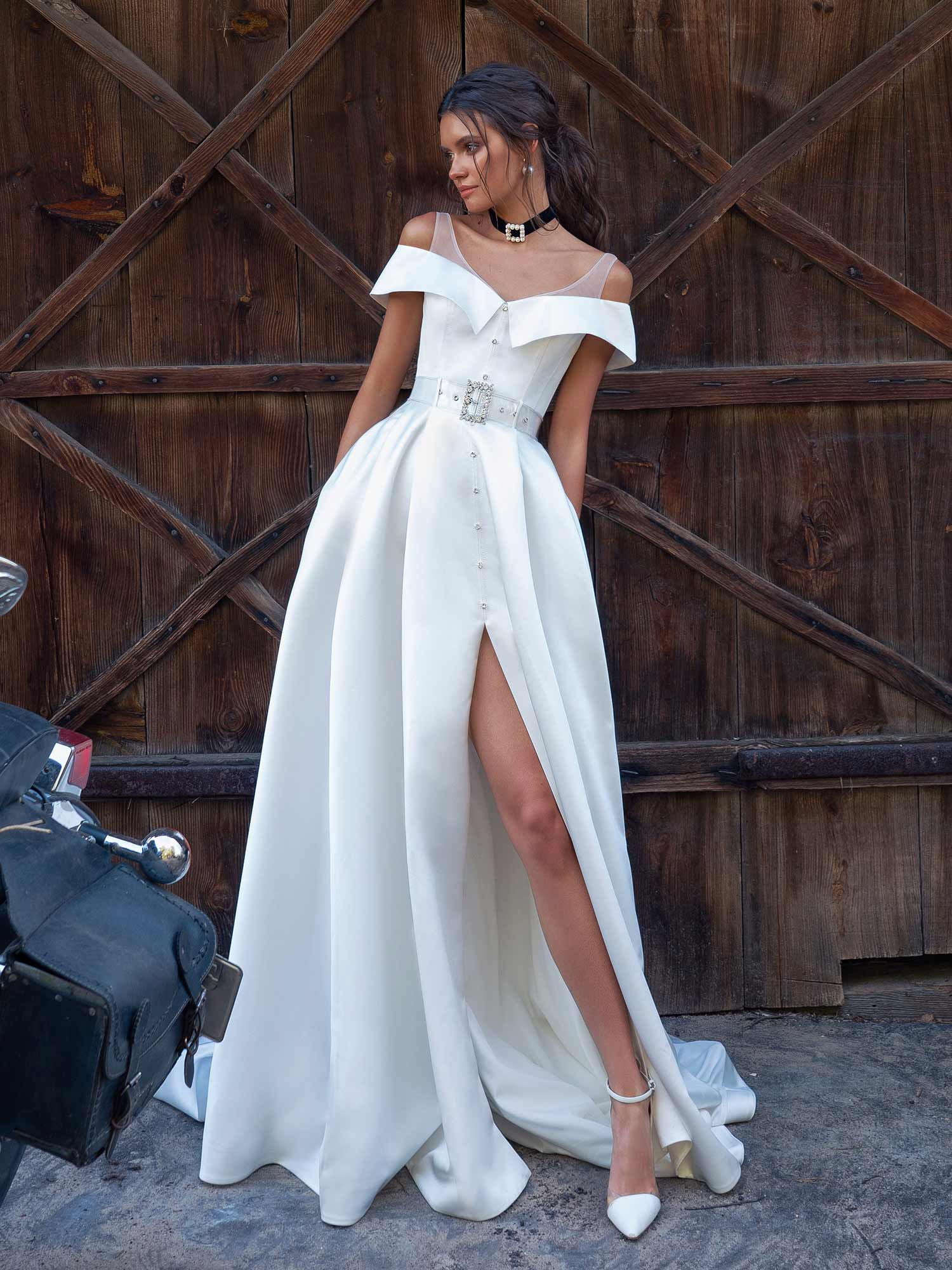 Style #12075, modern wedding dress with slit up the leg, available in ivory