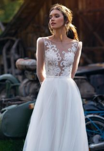 Style #12076, illusion long-sleeved wedding dress with embroidery, available in ivory, ivory-nude