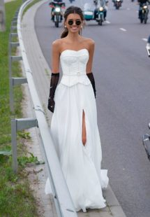 Style #12083, simple wedding dress with dropped waist and pearl details, available in ivory