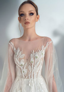 Style #2107, cape sleeve A-line wedding dress with floral applique, available in ivory-nude, ivory (lace is possible only as in the photo)