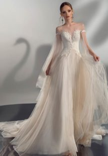 Style #2114, A-line wedding dress with cape sleeves, available in cream, ivory