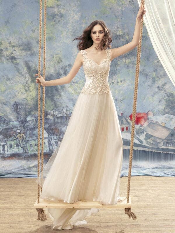 Sheath wedding dress with lace top and illusion back