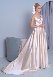Style #2224L, Atlas A-line wedding dress with a plunging neckline, open back and side pockets, available in gold, white