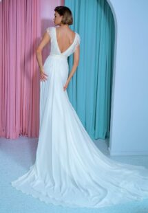 Style #2212L, chiffon sheath wedding gown with embroidered plunging V-neckline and open back, available in ivory
