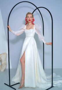 Style #2216L, long-sleeve A-line wedding dress with bishop style sleeves and high slit skirt, available in ivory