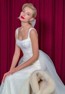 Style #2214L, sequinned lace fit and flare wedding dress with detachable tulle train, available in ivory