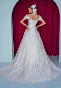 Style #2231L, organza ball gown with off the shoulder straps and floral decor, available in ivory