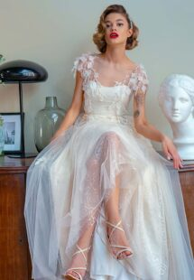 Style #2222, A-line wedding dress with 3D floral decor and sequinned floral lace layer, available in ivory