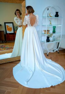 Style #2227L, crepe A-line wedding dress with bishop style sleeves and open back, available in ivory