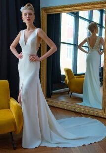 Style #2228L, crepe fit and flare wedding dress with floral embroidered V-back, available in ivory