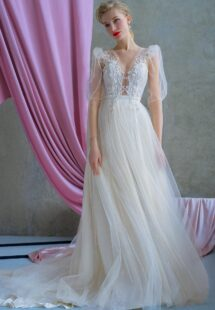 Style #2225, shimmering tulle A-line wedding dress with long puffed sleeves and floral embroidery, available in ivory