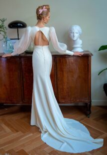 Style #2208L, V-neck fit and flare wedding dress with organza bishop-style sleeves, available in ivory
