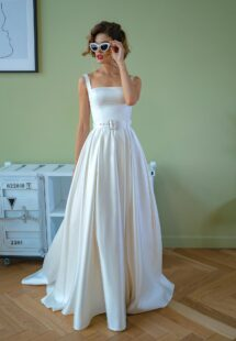 Style #2209-1, satin ball gown wedding dress with square neckline and belt, available in ivory