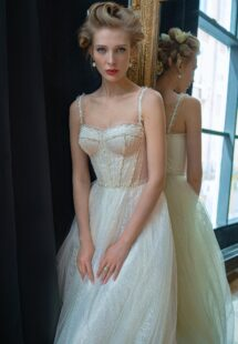 Style #2230L, sparkling lace A-line wedding dress with a beaded bustier top, available in ivory