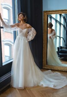 Style #2207L, strapless A-line wedding dress with long puffy sleeves, available in ivory