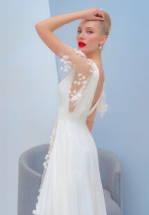 Style #2226L, flutter sleeve chiffon dress with a high slit and 3D floral decor, available in ivory