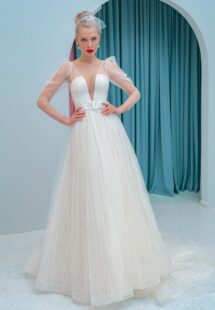 Style #2200L, A-line wedding dress with a plunging neckline, long sleeves and puffed shoulders, available in ivory