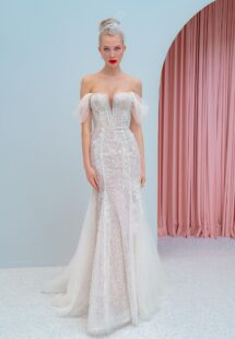 Style #2223, shimmering lace fit and flare wedding dress with detachable off the shoulder sleeves and tulle train, available in ivory, ivory-nude